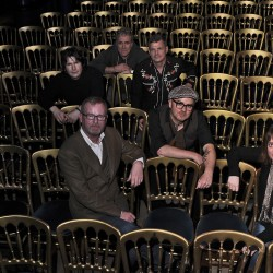 Dean Owens and the Whisky Hearts sitting on chairs at Oran Mor; photo by Louis de Carlo
